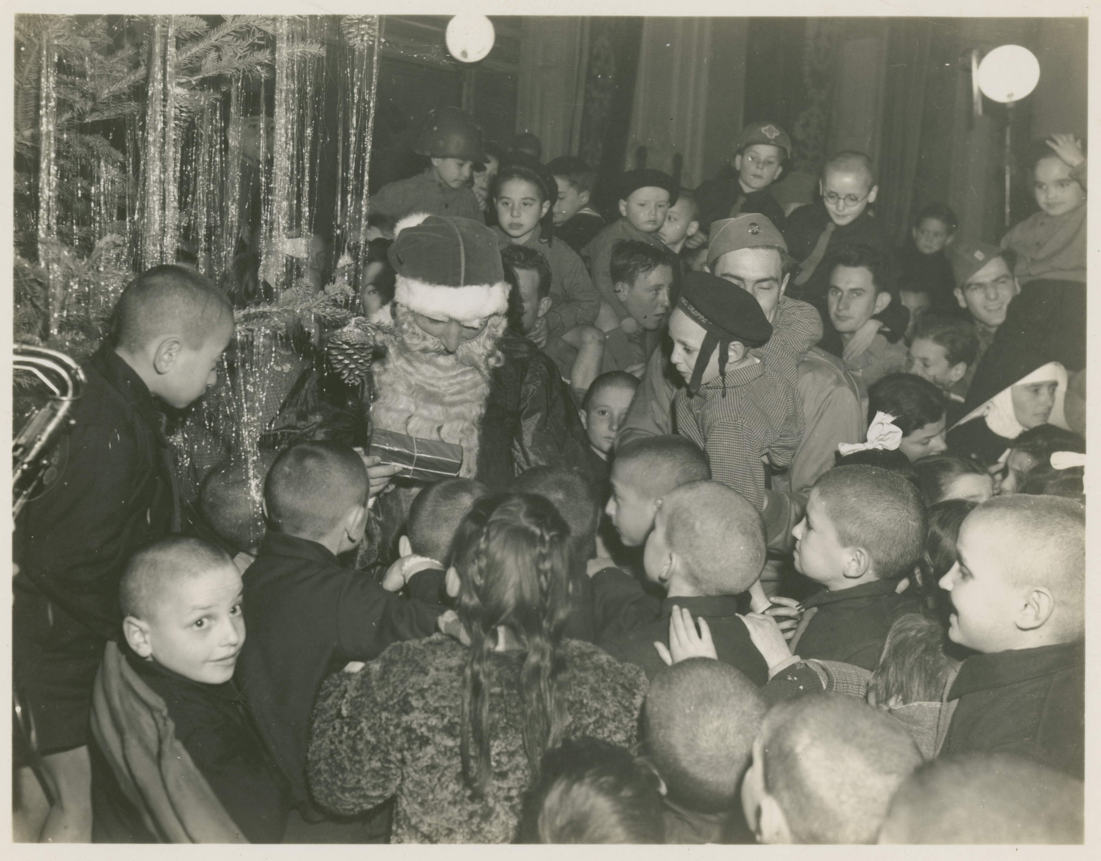 Ww2 Christmas Gifts.American Officer Dressed As Santa Claus Hands Out Gifts To