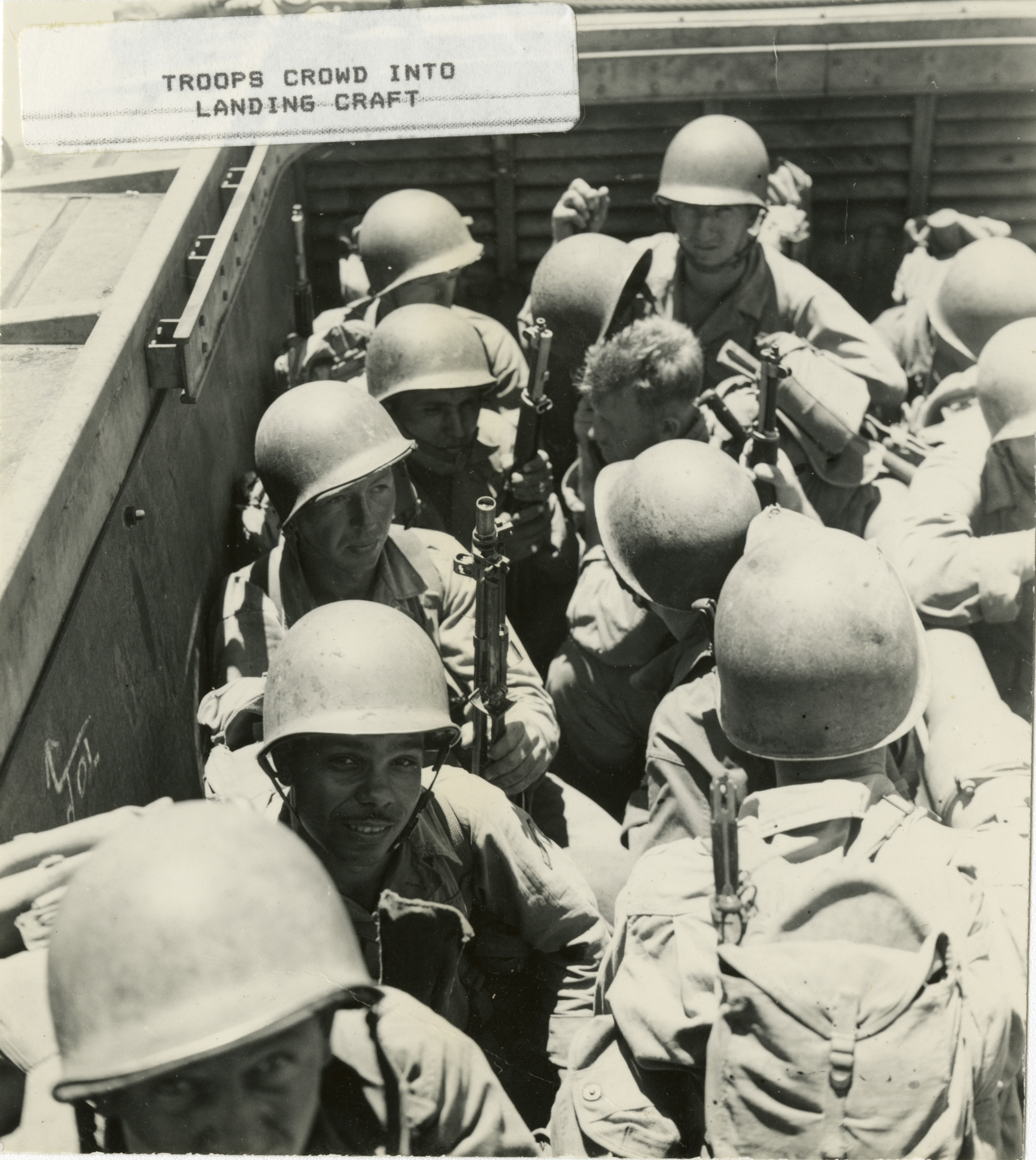 Soldiers of the 40th Infantry Division crowded into an LCVP