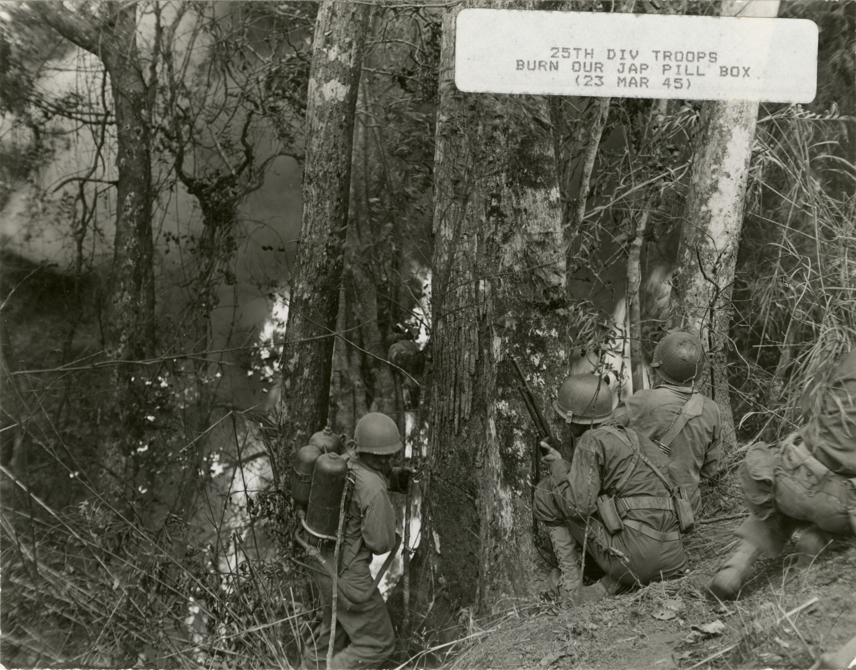 25th Infantry Division troops burn out a Japanese pill box