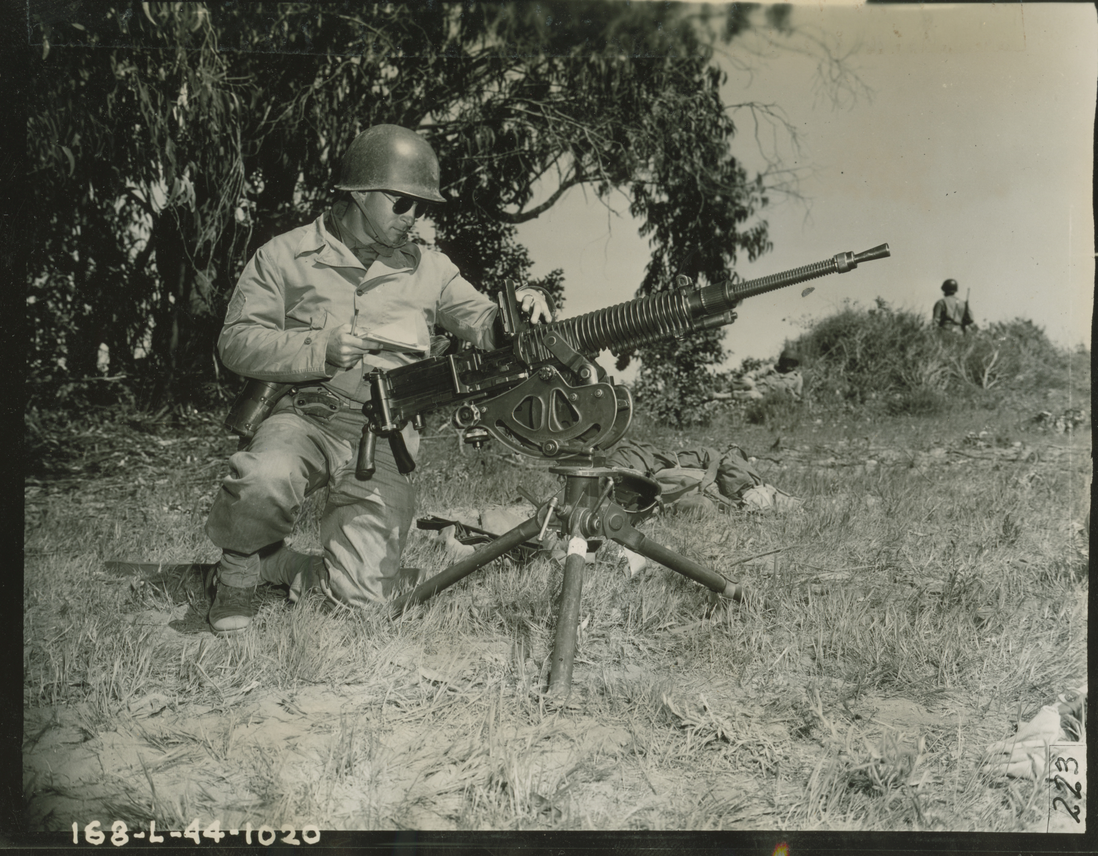US soldier inspecting Japanese machine gun during training ...